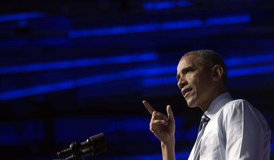 President Barack Obama speaks at a campaign event for the Ohio Democratic Party and for the Senate bid for former Ohio Gov. Ted Strickland at the Greater Columbus Convention Center in Columbus, Ohio, Thursday, Oct. 13, 2016. (AP Photo/Susan Walsh)