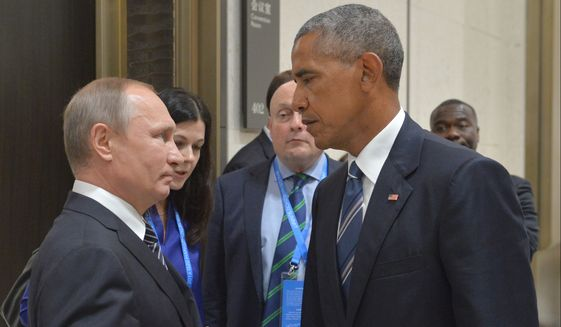 """FILE - In this Sept. 5, 2016 file photo, Russian President Vladimir Putin, left, speaks with U.S. President Barack Obama in Hangzhou in eastern China's Zhejiang province. The Russian Foreign Ministry said on Thursday, Oct. 13, 2016, that the United States is conducting a """"scorched earth"""" policy in relation to Russia during the final months of Obama's presidency. (Alexei Druzhinin/Sputnik, Kremlin Pool Photo via AP, File)"""