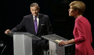 U.S. Sen. Richard Burr, R-N.C., left, listens to Democratic challenger Deborah Ross during a live televised Senate debate at UNC-TV studios in Research Triangle Park, N.C., Thursday, Oct. 13, 2016. (AP Photo/Gerry Broome, Pool)