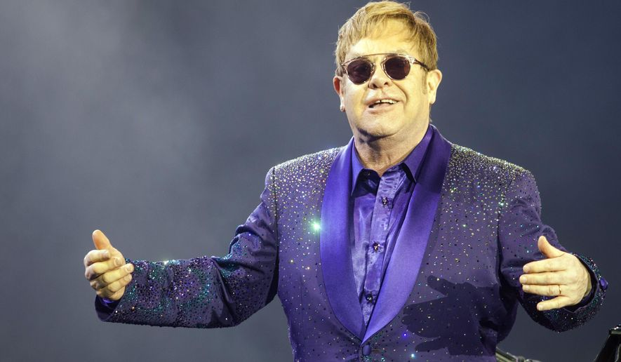 "FILE- In this Thursday, May 26, 2016 file photo, musician Elton John performs during a show in Tel Aviv. Elton John is chronicling his ""crazy life"" in an autobiography to be published in 2019, he said in a statement on Thursday, Oct. 13, 2016. (AP Photo/Dan Balilty, File)"