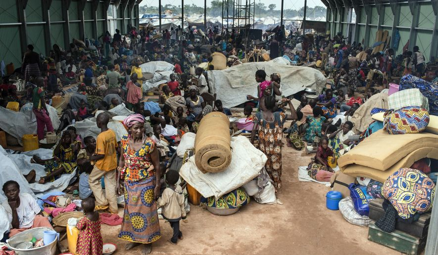 In this photo provided by International Rescue Committee, hundreds of refugees seek shelter in a hangar at the United Nations peacekeeping base in Kaga Bandoro refugee camp in Central African Republic, Thursday, Oct. 13, 2016. Fighters with the former Seleka rebel group attacked a northern town in Central African Republic overnight Wednesday, and clashes left at least 30 dead and 57 wounded as United Nations peacekeepers confronted them, the U.N. said. The attack in Kaga-Bandoro was likely retaliation for the death on Tuesday of a suspected former Seleka member, the peacekeeping mission said in a statement. Peacekeepers repelled the attackers, killing at least 12 of them, the U.N. mission said. (David Belluz/International Rescue Committee via AP)