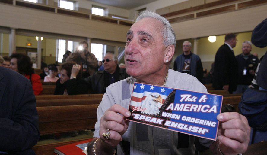FILE - In this Dec. 14, 2007, file photo, Joseph Vento, owner of Geno's Steaks in Philadelphia, displays a sign that was displayed at his restaurant during a recess of a Commission on Human Relations hearing in Philadelphia. The landmark Philadelphia cheesesteak stand has removed the sign posted a decade ago that told customers to order only in English. Late owner Joey Vento said at the time he posted it because of concerns over immigration reform and the increasing number of people who couldn't order in English. (AP Photo/Matt Rourke, File)