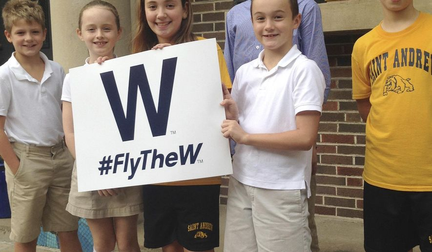 In this Oct. 6, 2016 photo, from left, Sean Leahy, Kaitlin Reap, Addison Casavechia, Connor Burns, blue shirt, Quinn Roberts and Max Oldham, students at Hawthorne Elementary School near Wrigley Field in Chicago, hold a Cubs W sign outside the school. It was one of 500 W's that the Cubs gave the school for the kids, who took them home last week. Every postseason run by the Cubs is accompanied by a fear of failure for its diehard fans. But young supporters of the Cubs know little of billy goat curses and botched plays, and they are confident of a World Series win. (AP Photo by Don Babwin)
