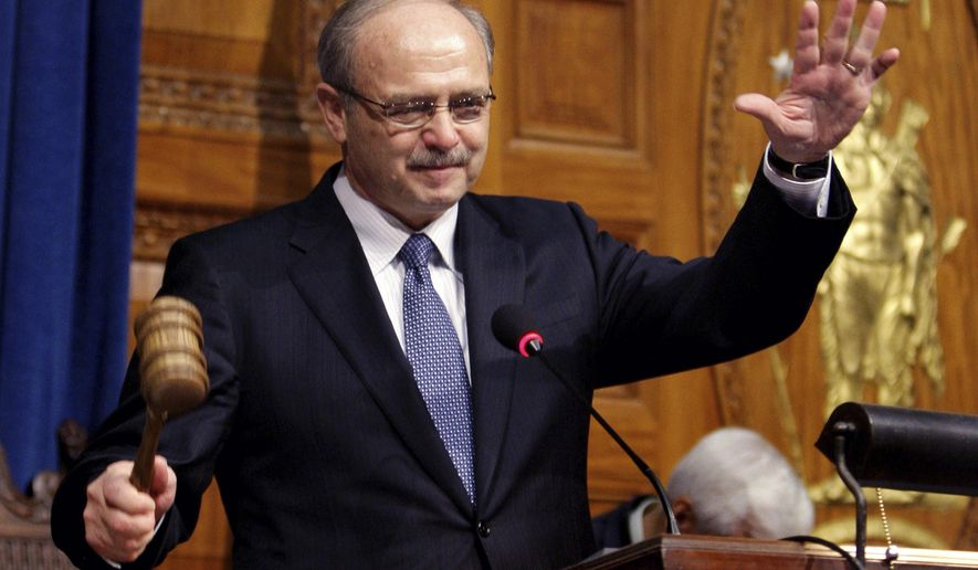 FILE-- This Jan. 7, 2009 file photograph shows Massachusetts House Speaker Salvatore DiMasi acknowledging applause from the chamber as he bangs the gavel after being re-elected at the Statehouse in Boston.  Federal officials are recommending an early release from prison for DiMasi as he battles cancer. The U.S. Bureau of Prisons is filing a notice in court saying it's requesting compassionate release for the once-powerful Democrat, who has served almost five years of an eight-year term for corruption. (AP Photo/Charles Krupa)