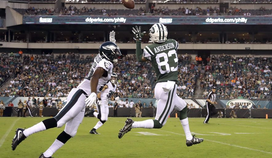 FILE - In this Sept. 1, 2016, file photo, New York Jets' Robby Anderson (83) pulls in a pass for an eventual touchdown against Philadelphia Eagles' JaCorey Shepherd, left, during the first half of a preseason NFL football game, in Philadelphia. Brandon Marshall realizes the Jets suffered a big loss when fellow wide receiver Eric Decker went down for the season with a shoulder injury. He also knows it's up to the youngsters on the roster to take advantage of this sudden opportunity. Sure, guys such as Robby Anderson, Jalin Marshall and Charone Peake are rookies, but Brandon Marshall is their biggest cheerleader these days.(AP Photo/Matt Rourke, File)