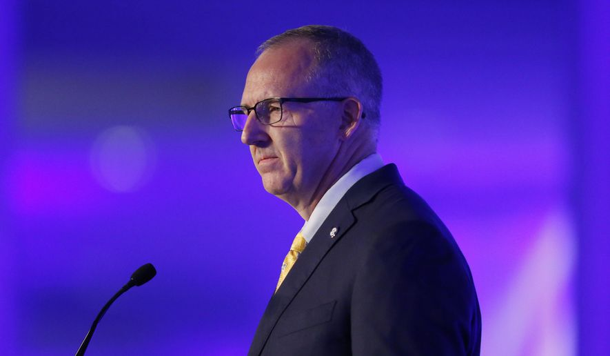 FILE - In this July 11, 2016, file photo, Southeastern Conference Commissioner Greg Sankey speaks to the media at the SEC NCAA college football media days in Hoover, Ala. LSU and Florida will play Nov. 19 at Tiger Stadium in Baton Rouge, a game rescheduled because of Hurricane Matthew.The SEC made the announcement Thursday, Oct. 13, ending a week of speculation about what would happen to the game originally scheduled for last Saturday in Gainesville. (AP Photo/Brynn Anderson, File)