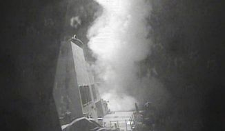 In this Thursday Oct. 13 photo released by U.S. Navy, the guided missile destroyer USS Nitze (DDG 94) launches a strike against coastal sites in Houthi-controlled territory on Yemen's Red Sea coast. U.S.-launched Tomahawk cruise missiles destroyed three coastal radar sites in Houthi-controlled territory on Yemen's Red Sea Coast early Thursday, officials said, a retaliatory action that followed two incidents this week in which missiles were fired at U.S. Navy ships.  (U.S. Navy via AP)