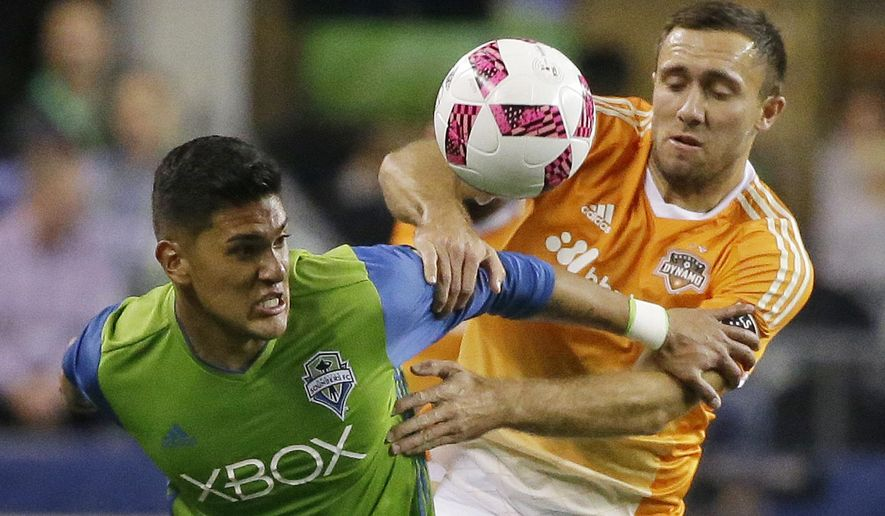 Seattle Sounders' Tony Alfaro, left, and Houston Dynamo's Andrew Wenger, right, battle for a loose ball in the first half of an MLS soccer match, Wednesday, Oct. 12, 2016, in Seattle. (AP Photo/Ted S. Warren)
