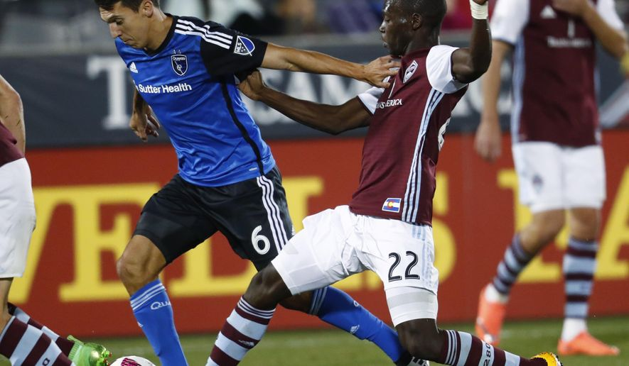 San Jose Earthquakes midfielder Shea Salinas, left, tries to drive past Colorado Rapids midfielder Michael Azira for a shot in the second half of an MLS soccer game Thursday, Oct. 13, 2016, in Commerce City, Colo.  (AP Photo/David Zalubowski)