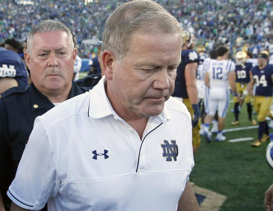 FILE - In this Sept. 24, 2016, file photo, Notre Dame head coach Brian Kelly walks off the field after an NCAA college football game against Duke, in South Bend, Ind. Duke defeated Notre Dame 38-35. When crunch time comes, the Irish offense is the one being crunched. The Irish (2-4) have had four chances to win or tie on their last possessions this season. They are 0-for-4. (AP Photo/Charles Rex Arbogast, File)