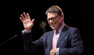 Former Republican presidential candidate and former Texas Gov. Rick Perry, waves to the crowd as he steps to the podium to speak at the RedState Gathering in Atlanta, in this Aug. 7, 2015, file photo. (AP Photo/David Goldman, File)