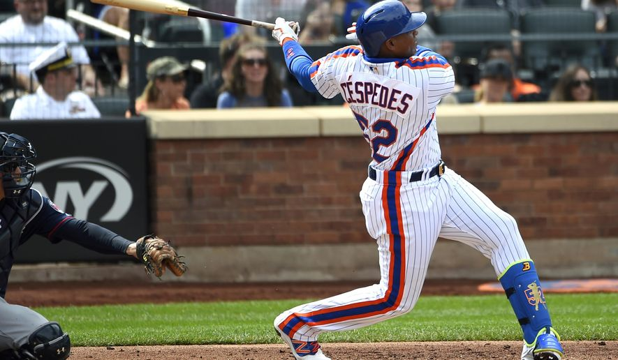 FILE - In this Sept. 18, 2016, file photo, New York Mets' Yoenis Cespedes swings for a double as John Ryan Murphy catches for the Minnesota Twins in the third inning of a baseball game, in New York. The price of qualifying offers for Major League Baseball free agents will be $17.2 million this year.The figure, announced Thursday, Oct. 13, 2016, is up 8.9 percent from $15.8 million last year. (AP Photo/Kathy Kmonicek, File)