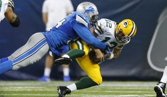FILE - In this Dec. 3, 2015, file photo, Green Bay Packers quarterback Aaron Rodgers (12) is sacked by Detroit Lions defensive end Ezekiel Ansah (94) during the second half of an NFL football game, in Detroit. The Lions and Los Angeles Rams play on Sunday, Oct. 16, 2016.  (AP Photo/Rick Osentoski, File)