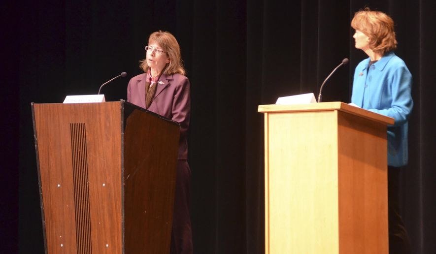 Senate candidates Margaret Stock, left, an independent, and Republican Sen. Lisa Murkowski participate in a fisheries debate with Democrat Ray Metcalfe and independent Breck Craig in Kodiak, Alaska, Wednesday, Oct. 12, 2016. Murkowski squared off against three of her rivals in Kodiak Wednesday night, defending her record on fisheries issues in her first debate before next month's election. (Drew Herman/Kodiak Daily Mirror via AP)