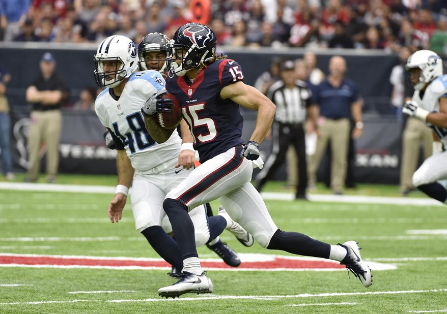 FILE - In this Oct. 2, 2016, file photo, Houston Texans wide receiver Will Fuller (15) returns a punt 67-yards for a touchdown against the Tennessee Titans during the second half of an NFL football game in Houston. The  Titans have given up punt returns for touchdowns in consecutive games, the first costing an assistant coach his job. (AP Photo/Eric Christian Smith, File)