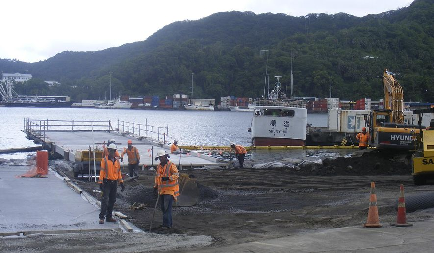 In this photo taken Nov. 28, 2014, construction on a new unloading dock is underway at Tri Marine International's Samoa Tuna Processors Inc., plant under construction in the U.S. territory of American Samoa.  In a statement,   Tri Marine says it will end production indefinitely at its Samoa Tuna Processors cannery plant. The company's 800 employees were informed of the plan Thursday, Oct. 13, 2016. The company didn't specify how many will be affected.  (AP Photo/Fili Sagapolutele)