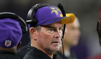 ADVANCE FOR WEEKEND EDITIONS, OCT. 15-16 - FILE - In this Sept. 18, 2016, file photo, Minnesota Vikings head coach Mike Zimmer stands on the sidelines during the first half of an NFL football game against the Green Bay Packers in Minneapolis. The Vikings have been so far able to endure a slew of injuries to important players that many other teams wouldn't, with a well-constructed roster of players exemplifying coach Zimmer's defiant personality. They're the only undefeated team left in the NFL entering their bye week. (AP Photo/Andy Clayton-King, File)