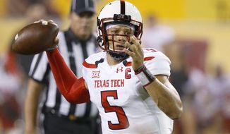 FILE - In this Sept. 10, 2016, file photo, Texas Tech's Patrick Mahomes looks to pass against Arizona State during the first half of an NCAA college football game, in Tempe, Ariz. West Virginia will find out whether a defense that began the season with eight new starters is ready for the nation's passing leader when they travel to Texas Tech on Saturday to face Patrick Mahomes.(AP Photo/Ross D. Franklin, File)