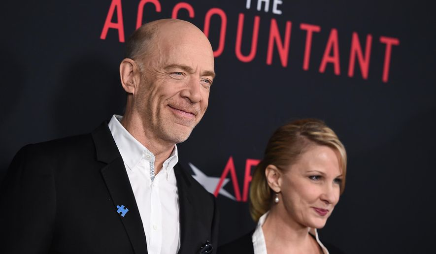 "J.K. Simmons, left, and Michelle Schumacher arrive at the world premiere of ""The Accountant"" at the TCL Chinese Theatre on Monday, Oct. 10, 2016, in Los Angeles. (Photo by Jordan Strauss/Invision/AP)"