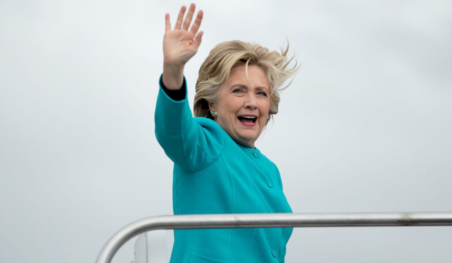Democratic presidential candidate Hillary Clinton boards her campaign plane at Boeing Field Airport in Seattle, Friday, Oct. 14, 2016, to travel to White Plains, N.Y. (AP Photo/Andrew Harnik)