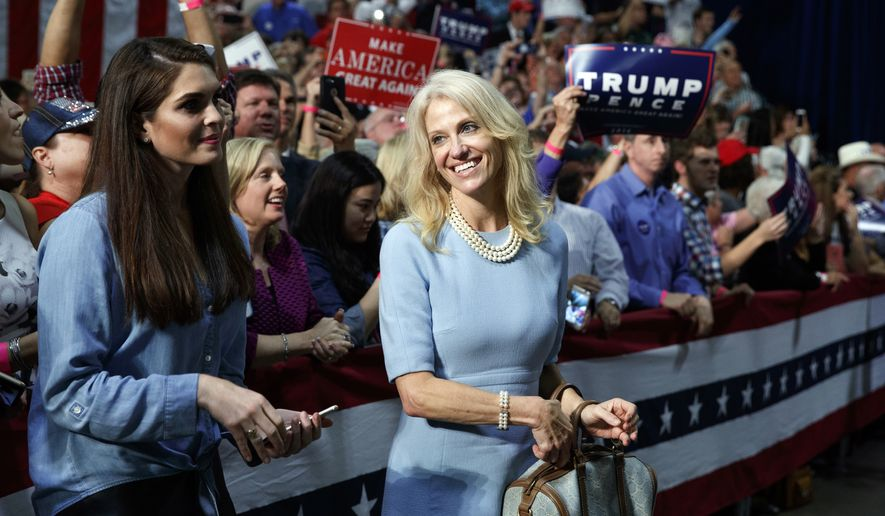 Kellyanne Conway, campaign manager for Republican presidential candidate Donald Trump, right, and press secretary Hope Hicks watch during a campaign rally, Friday, Oct. 14, 2016, in Charlotte, N.C. (AP Photo/ Evan Vucci)