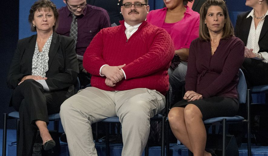Oct. 9, 2016, file photo, Kenneth Bone sits in the audience before the start of the second presidential debate at Washington University in St. Louis. (AP Photo/Andrew Harnik, File)