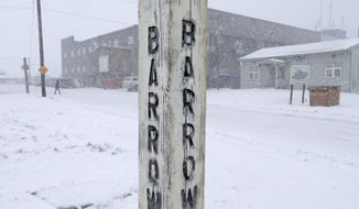 In this Oct. 10, 2014, file photo, snow falls around a sign in Barrow, Alaska. Residents in Barrow, the nation's northernmost community, have voted to change the name of their city back to its traditional Inupiaq name of Utqiagvik. (AP Photo/Gregory Bull, File)