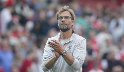 FILE - A Sunday Aug. 14, 2016 file photo showing Liverpool's manager Jurgen Klopp applauding the fans after winning the English Premier League soccer match between Arsenal and Liverpool at the Emirates Stadium in London.  It's a year since Juergen Klopp breezed into English football as the new manager of Liverpool, and the bespectacled, fun-loving German has established himself as the most charismatic coach in the Premier League. He's proving to be the shrewdest, too. (AP Photo/Tim Ireland, File)