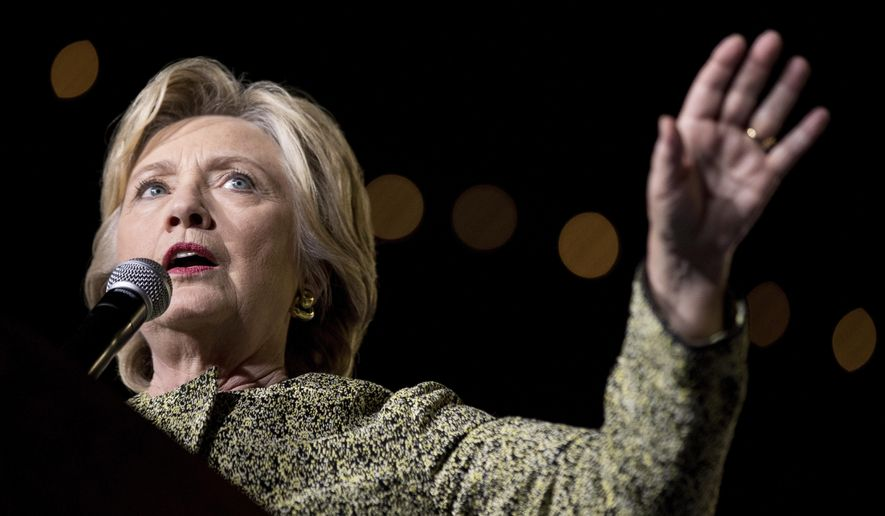 "File-This photo taken Oct. 12, 2016, shows Democratic presidential candidate Hillary Clinton speaking  at a rally at the Smith Center for the Performing Arts in Las Vegas.  Clinton privately said the U.S. would ""ring China with missile defense"" if the Chinese government failed to curb North Korea's nuclear program, a potential hint at how the former secretary of state would act if elected president. (AP Photo/Andrew Harnik, File)"
