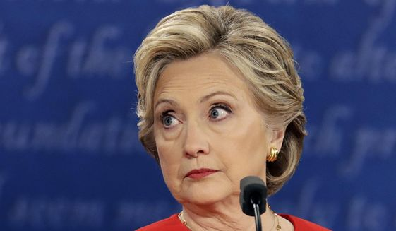 In this Sept. 26, 2016, file photo, Democratic presidential nominee Hillary Clinton listens to Republican presidential nominee Donald Trump during the U.S. presidential debate at Hofstra University in Hempstead, N.Y.  (AP Photo/Julio Cortez, File)