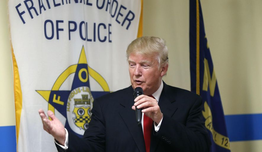 FILE - In this Aug. 18, 2016, file photo, Republican presidential candidate Donald Trump speaks to retired and active law enforcement personnel at a Fraternal Order of Police lodge during a campaign stop in Statesville, N.C. The endorsement by a national police organization for Trump has exposed a divide within the ranks of law enforcement: Can they support someone who calls himself the law-and-order candidate, but was caught on tape bragging about sexually predatory behavior toward women? And what about his antagonizing the very minority communities that police agencies need to win over amid turmoil over police shootings of unarmed black men? (AP Photo/Gerald Herbert, File)