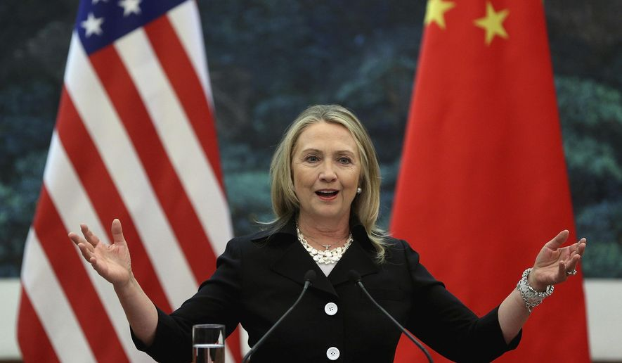"In this Sept. 5, 2012, file photo, then U.S. Secretary of State Hillary Clinton speaks during her joint conference with Chinese Foreign Minister Yang Jiechi at the Great Hall of the People in Beijing when talks between Clinton and Chinese leaders failed to narrow gaps on how to end the crisis in Syria and how to resolve Beijing's territorial disputes with its smaller neighbors over the South China Sea. Clinton privately said the U.S. would ""ring China with missile defense"" if the Chinese government failed to curb North Korea's nuclear program, a potential hint at how the former secretary of state would act if elected president. Clinton's remarks were revealed by WikiLeaks in a hack of the Clinton campaign chairman's personal account. (Feng Li/Pool Photo via AP, File)"