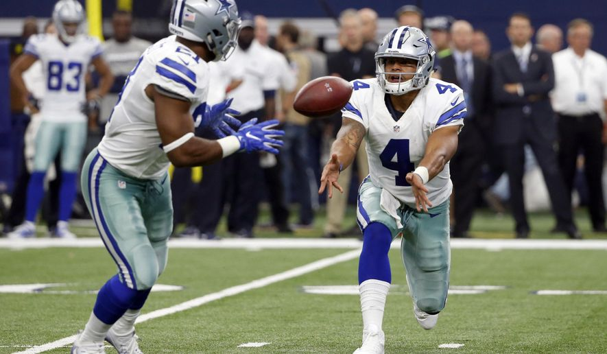 FILE - In this Sept. 11, 2016, file photo, Dallas Cowboys quarterback Dak Prescott (4) pitches the ball to running back Ezekiel Elliott (21) during an NFL football game against the  New York Giants in Arlington, Texas. Prescott and Elliott started the season as a Dallas novelty not seen since Roger Staubach and Calvin Hill nearly 50 years ago. Now the rookie quarterback-running back combo is setting NFL records. (AP Photo/Michael Ainsworth, File)