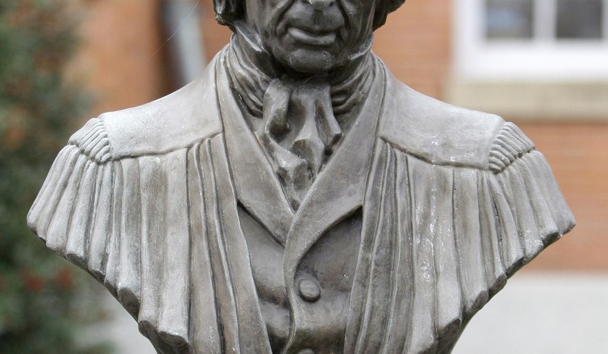 FILE - In this Nov. 17, 2009 file photo, a statue of Supreme Court Chief Justice Roger Brooke Taney is displayed in front of City Hall, in Frederick, Md.  The Maryland city has cleared what could be the last obstacle to its plan to rid the City Hall courtyard of the statue of the man who wrote the 1857 Dred Scott decision affirming slavery. The city of Frederick's Historic Preservation Commission voted 4-1 Thursday, Oct. 13, 2016, to allow the removal of the bust of Taney, and a nearby bust of Maryland's first governor, Thomas Johnson, who owned slaves. (AP Photo/Rob Carr, File)