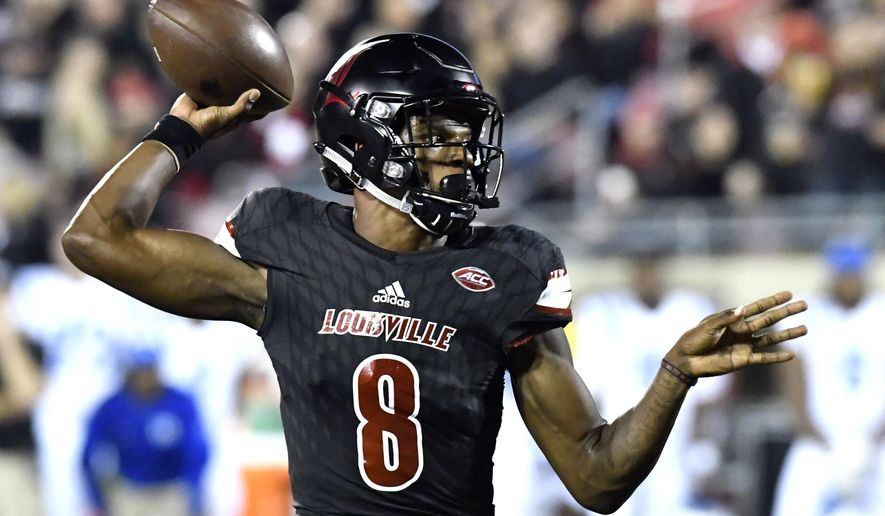 Louisville's Lamar Jackson (8) attempts a pass during the first half of an NCAA college football gamen against Duke, Friday, Oct. 14, 2016, in Louisville, Ky. (AP Photo/Timothy D. Easley)