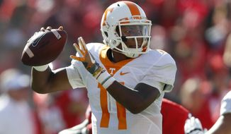 FILE - In this Oct. 1, 2016, file photo, Tennessee quarterback Joshua Dobbs throws from the pocket in the first half of an NCAA college football game against Georgia in Athens, Ga. Dobbs is fourth in the nation in total yards at 333.7 per game and he has accounted for 19 touchdowns (14 passing, five rushing). (AP Photo/John Bazemore)