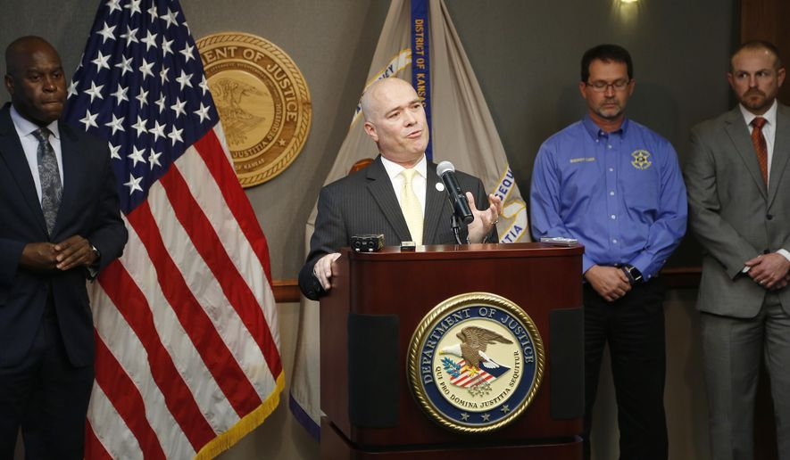 Acting U.S. Attorney Tom Beall announced Friday, Oct. 14, 2016, a major federal investigation stopped a domestic terrorism plot by a militia group to detonate a bomb at a Garden City apartment complex where a number of Somalis live. Two Liberal men and a Dodge City resident were arrested and charged in federal court with domestic terrorism charges, (Bo Rader/The Wichita Eagle via AP)