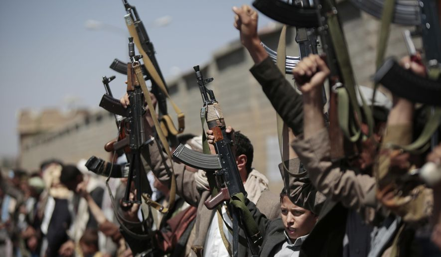 Tribesmen loyal to Houthi rebels hold their weapons as they chant slogans during a gathering aimed at mobilizing more fighters into battlefronts in several Yemeni cities, in Sanaa, Yemen, on Oct. 2, 2016. (Associated Press) **FILE**