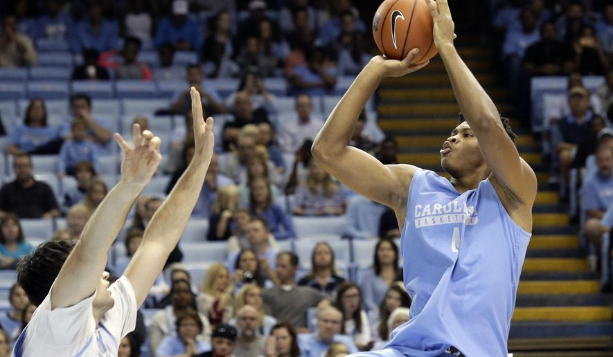 North Carolina's Isaiah Hicks, right, shoots during the NCAA college basketball team's season kickoff event, Late Night With Roy, in Chapel Hill, N.C., Friday, Oct. 14, 2016. (AP Photo/Gerry Broome)
