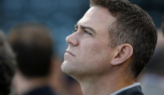 Chicago Cubs president for baseball operations Theo Epstein looks up during the team practice before baseball's National League Championship Series against the Los Angeles Dodgers, Friday, Oct. 14, 2016, in Chicago. The Cubs host Game 1 of the series against the Dodgers on Saturday. (AP Photo/Charles Rex Arbogast)