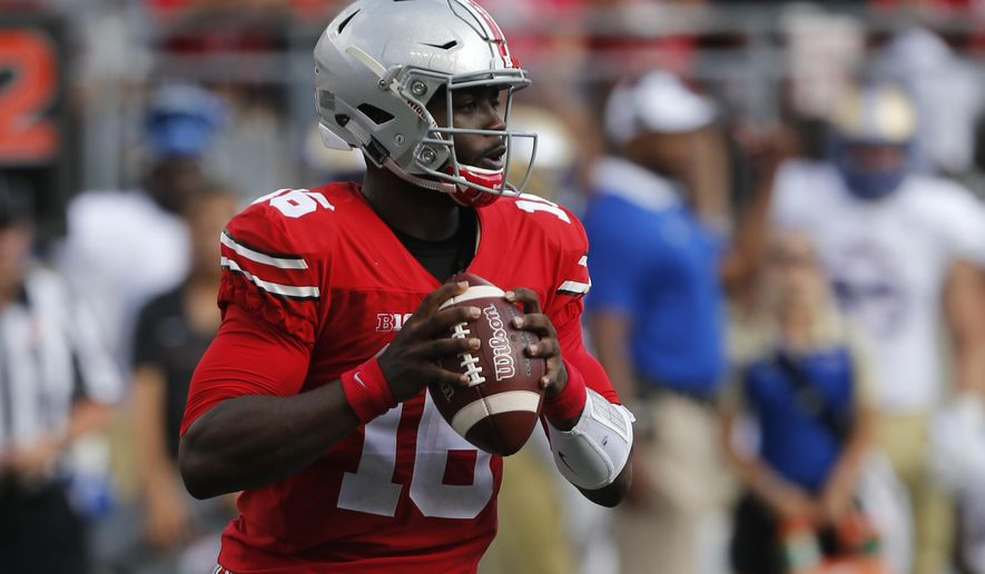 FILE - In this Sept. 10, 2016, file photo, Ohio State quarterback J.T. Barrett plays against Tulsa during the first half of an NCAA college football game in Columbus, Ohio. If he gets into trouble, Barrett can tuck the ball away and run. He had 137 yards and a score on a career-high 26 carries, which might be too many for the team's best player. (AP Photo/Jay LaPrete, File)