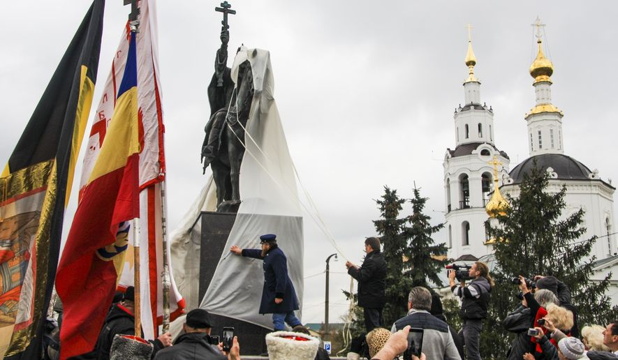 A monument to Czar Ivan the Terrible is unveiled in the city of Orel, 350 kilometers (225 miles) south of Moscow, in Orel, Russia, Friday, Oct. 14, 2016.  Despite local protests and court battles, the Russian city of Orel has unveiled the country's first monument to the brutal Czar, Ivan the Terrible on horseback, wielding both a sword and a cross. (AP Photo/Howard Amos)
