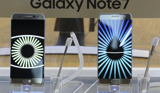 In this Tuesday, Oct. 11, 2016 photo, Samsung Electronics Galaxy Note 7 smartphones are displayed at its shop in Seoul, South Korea. Samsung Electronics said Thursday, Oct. 13, 2016, it has expanded its recall of Galaxy Note 7 smartphones in the U.S. to include all replacement devices the company offered as a presumed safe alternative after the original Note 7s were found prone to catch fire. (AP Photo/Lee Jin-man)