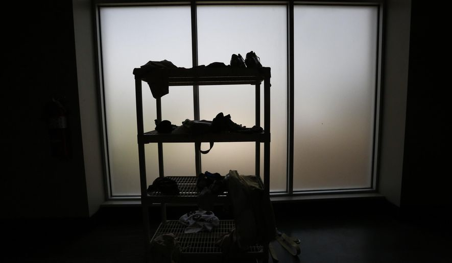 A group of UAB football cleats and dirty towels are seen silhouetted in the UAB locker room, Thursday, Aug. 25, 2016, in Birmingham, Ala. UAB shut down the football program for lack of financial support in December 2014; football will return for the 2017 season. UAB broke ground on a two-story, 46,000-square-foot two-story facility that will include offices, locker rooms, weight rooms and more. It's scheduled to open in July 2017. (AP Photo/Brynn Anderson)