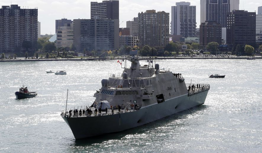 The USS Detroit, one of the United States Navy's newest warships, arrives Friday, Oct. 14, 2016, in Detroit. It's scheduled to be along the Riverwalk behind the Renaissance Center for a week of commissioning events. The Freedom-class ship is part of a new breed of naval vessel, which is designed to work in shallow waters and operate with speed and agility. It's created to be quickly modified to take on different missions. (AP Photo/Carlos Osorio)