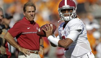 Alabama quarterback Jalen Hurts (2) warms up before an NCAA college football game against Tennessee as Alabama head coach Nick Saban watches Saturday, Oct. 15, 2016, in Knoxville, Tenn. (AP Photo/Wade Payne)