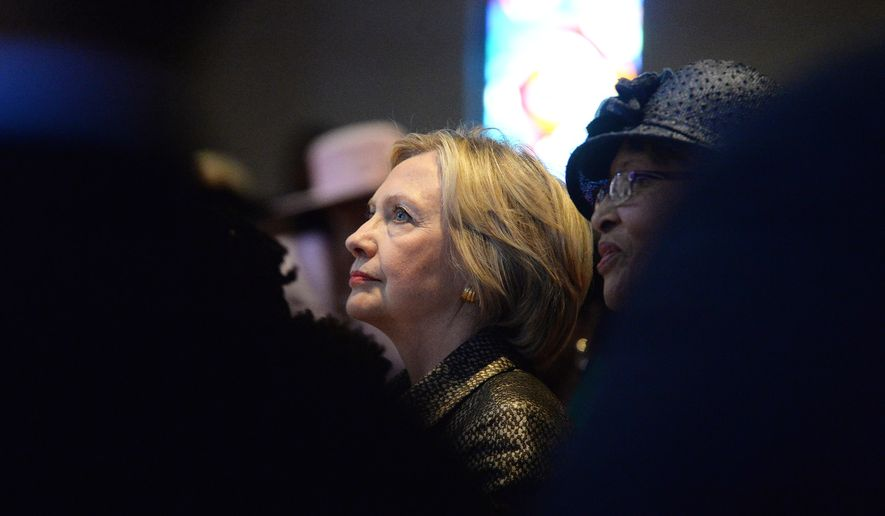 In this Sunday, Oct. 2, 2016 file photo, Democratic presidential candidate Hillary Clinton listens to a sermon after speaking at Little Rock AME Zion church in Charlotte, N.C. (Diedra Laird/Charlotte Observer via AP)