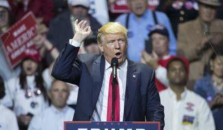 Republican presidential candidate Donald Trump speaks during a campaign rally, Thursday, Oct. 13, 2016, in Cincinnati. (AP Photo/John Minchillo)