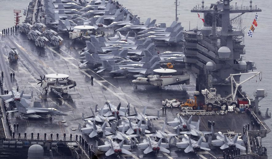 U.S. aircrafts sit on the USS Ronald Reagan aircraft carrier after completing a joint drill with the South Korean navy in southern waters off the Korean Peninsula, at Busan port, South Korea, Sunday, Oct. 16, 2016. South Korea and the U.S. said Sunday that the latest missile launch by North Korea ended in a failure after the projectile reportedly exploded soon after liftoff. (Jo Jong-ho/Yonhap via AP) KOREA OUT