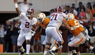 Alabama quarterback Jalen Hurts (2) throws downfield as he's pressured by Tennessee defensive lineman Jonathan Kongbo (1) during the first half of an NCAA college football game Saturday, Oct. 15, 2016, in Knoxville, Tenn. (AP Photo/Wade Payne)